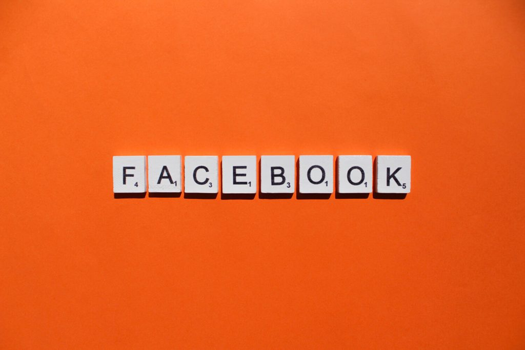 facebook scrabble letters word on a orange backgro QMWAFHF